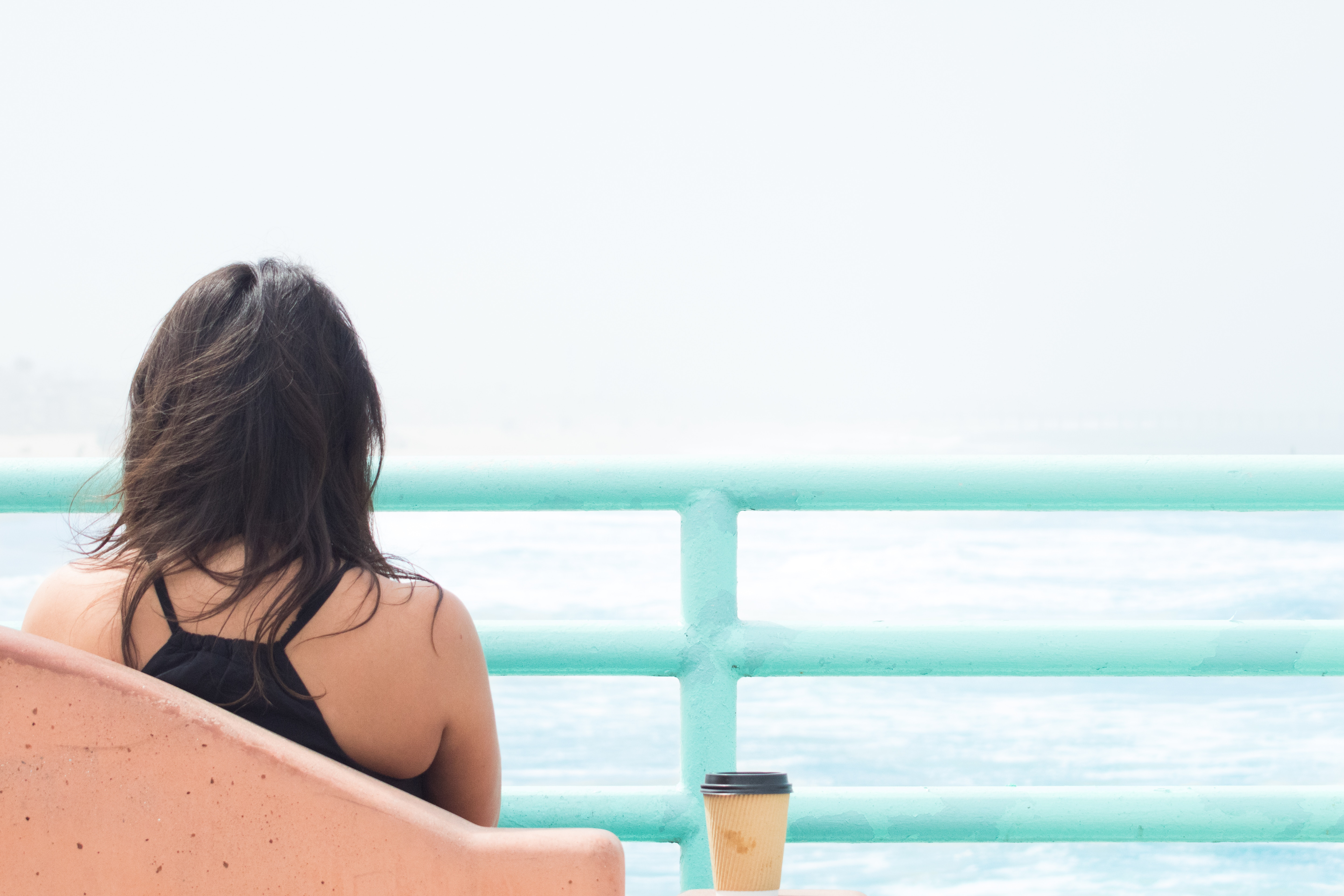 Get Recharged - Girl at beach with coffee